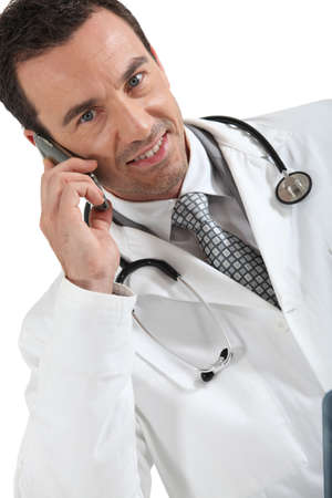 Male doctor with mobile telephone photo