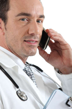 Doctor on phone smiling Stock Photo - 16901074