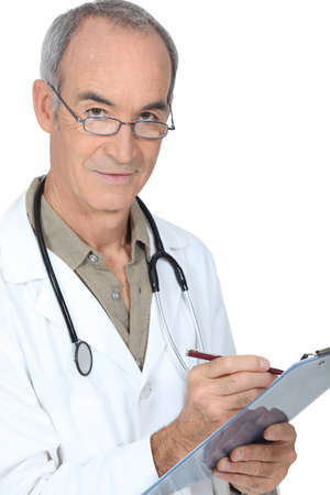 Medical professional writing on a clipboard photo