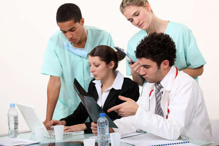 hospital staff analyzing a case photo