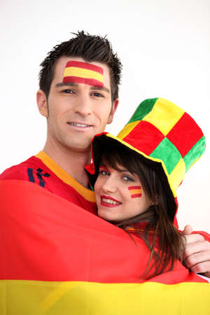 nationalists: Couple supporting the Spanish football team