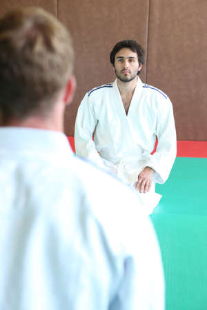 adversaries: two men in kimono facing each other Stock Photo