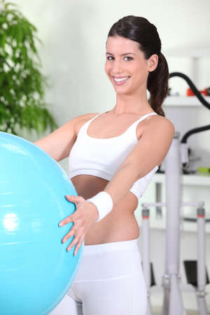 Young woman using an exercise ball photo
