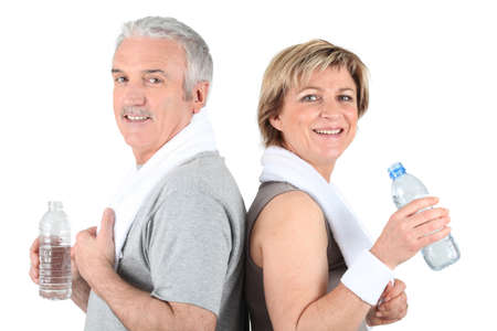 Mature couple drinking water Stock Photo - 16900943