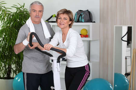 sportingly: Senior couple working out together