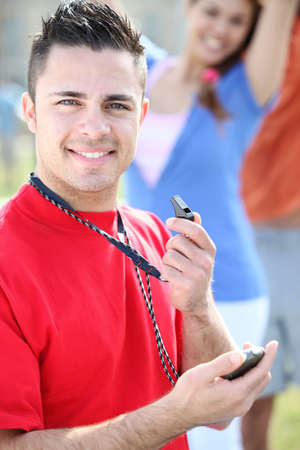 all smiles: young referee all smiles holding whistle Stock Photo