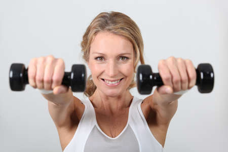 toning: Woman working out with dumbbells Stock Photo