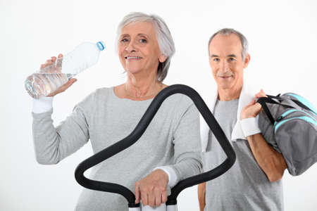 Elderly couple working out together photo