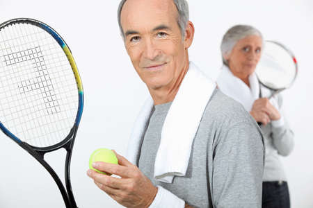 senior couple playing tennis photo