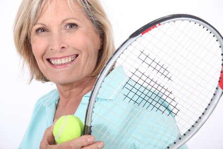 bridgework: Elderly woman playing tennis