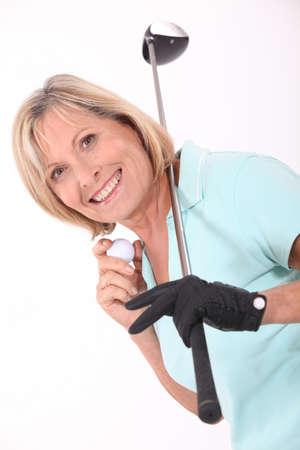 golfers: senior woman playing golf