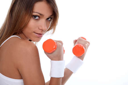 healthfulness: Woman training with weights