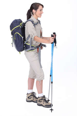 trekking pole: A hiker with her gear