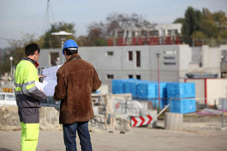 Foreman and colleague having a discussion whilst on site photo