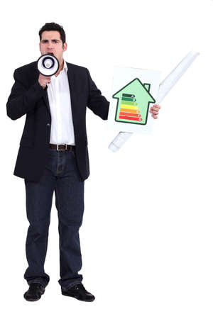 Man with a megaphone and energy rating card Stock Photo - 16900452
