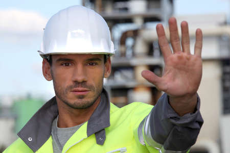 factory worker: Foreman restricting access Stock Photo