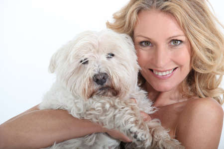 Woman with dog in arms. photo