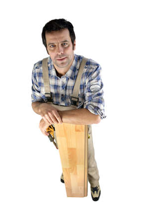 incertitude: Worried builder with planks of wood Stock Photo
