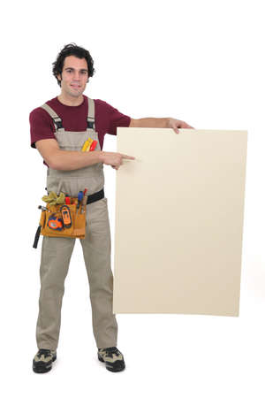 Handyman pointing to a blank sign photo
