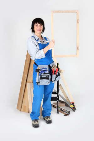 handiwork: A carpenter holding up her handiwork