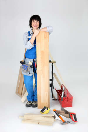 Woman about to lay laminate flooring photo