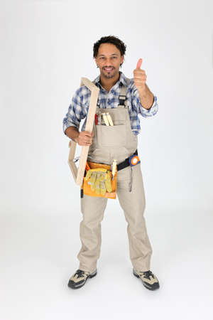 Male woodworker carrying frame Stock Photo - 16950431