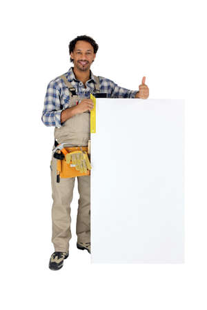 Tradesman using a try square to measure a board photo
