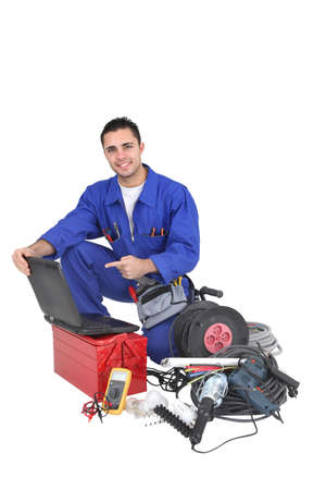 Electrician pointing to his portable computer Stock Photo - 16950216