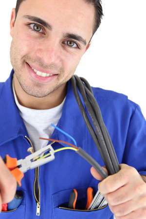 Electrician stripping wire photo