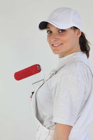 handywoman: handywoman painting a wall Stock Photo