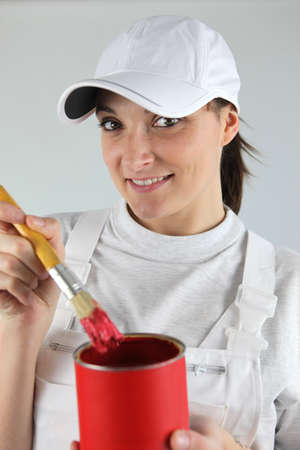 Female decorator has chosen red paint photo