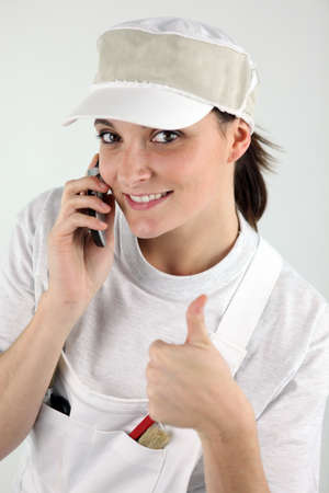 Decorator with a cellphone Stock Photo - 16950632