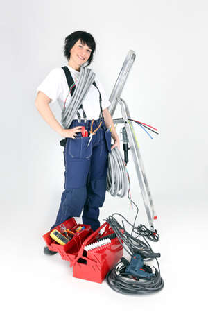jumpsuite: handywoman with many tools Stock Photo