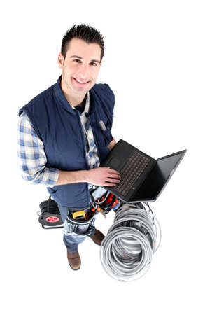 screened: Electrician with a blank screened laptop Stock Photo