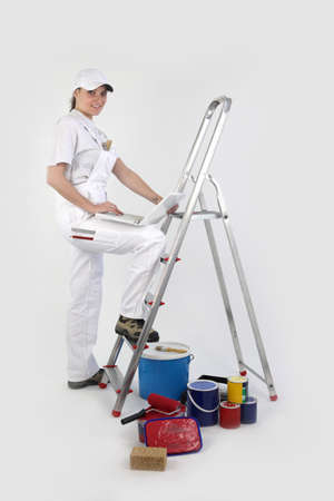 female painter on a ladder photo