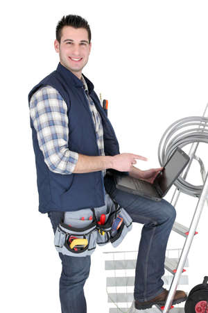 Happy electrician with his equipment on white background