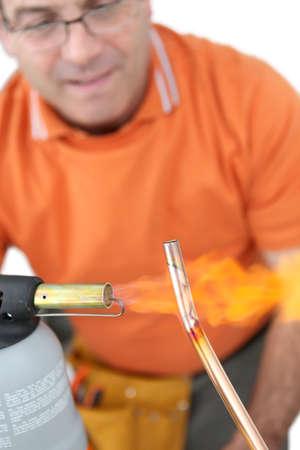 plumber using welding torch Stock Photo - 16950666