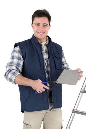 tiler: craftsman tiler with all his equipment