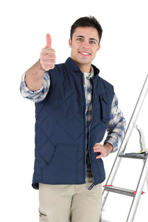 Tiles stood by his equipment giving thumbs-up Stock Photo - 16950037