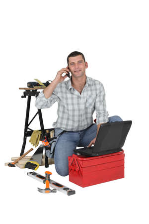 journeyman: Carpenter using the internet to order parts Stock Photo