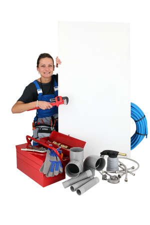 labourer: Female labourer surrounded by tools Stock Photo