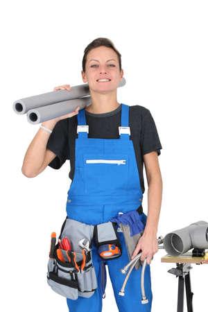 obrero: Mujer obrero estaba junto a las herramientas y equipos