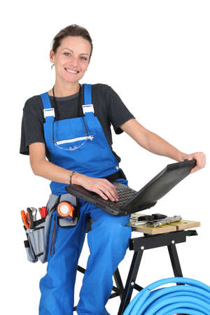 plumber woman with laptop Stock Photo - 16950200