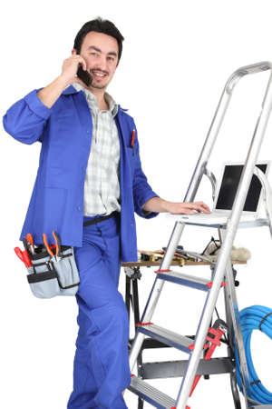 A tradesman with his tools and a stepladder Stock Photo - 16950220