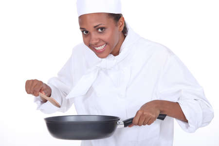 stirring: Female chef holding saucepan