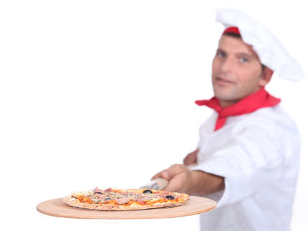 Cook serving pizza Stock Photo - 16950230