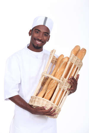 Baker with a basket of baguettes Stock Photo - 16950712