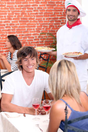 Young couple on a date in a pizzeria. photo