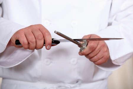 sharpening: Chef sharpening knife Stock Photo