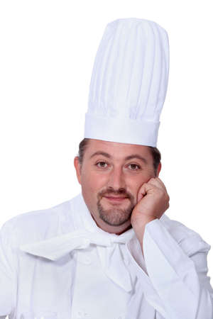 chefs whites: Portrait of a man in chefs whites and hat Stock Photo
